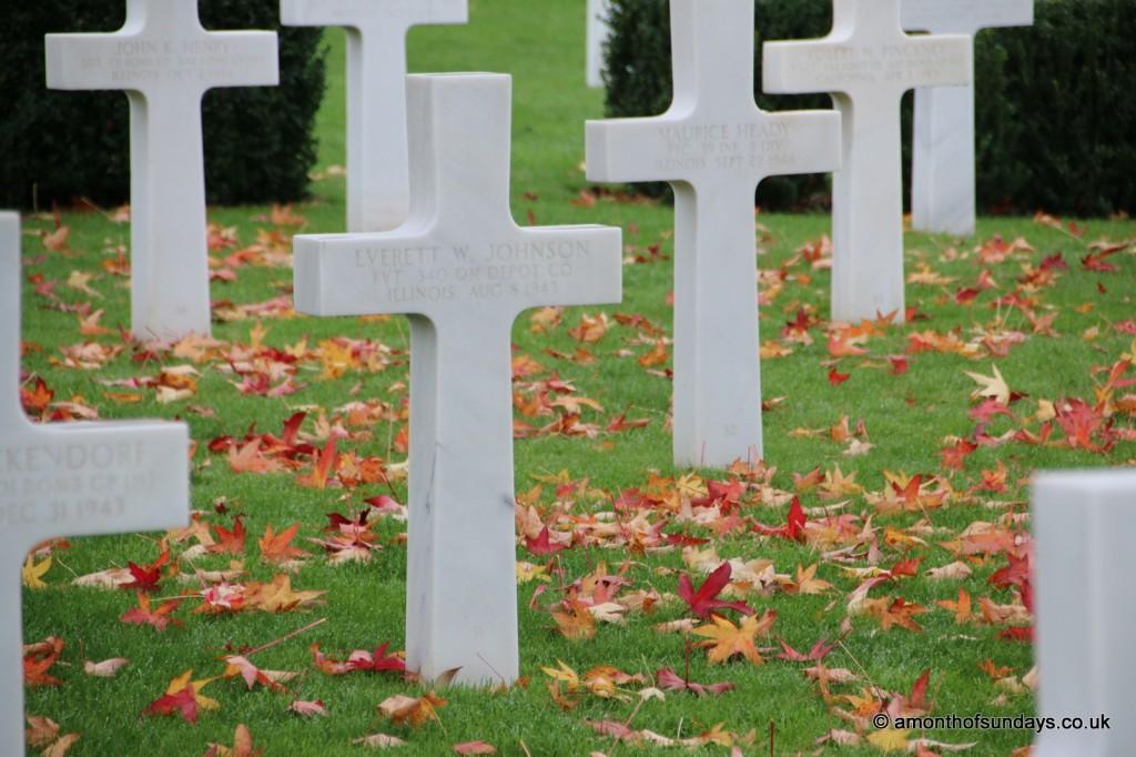 Leaves amongst crosses at American War Cemetery