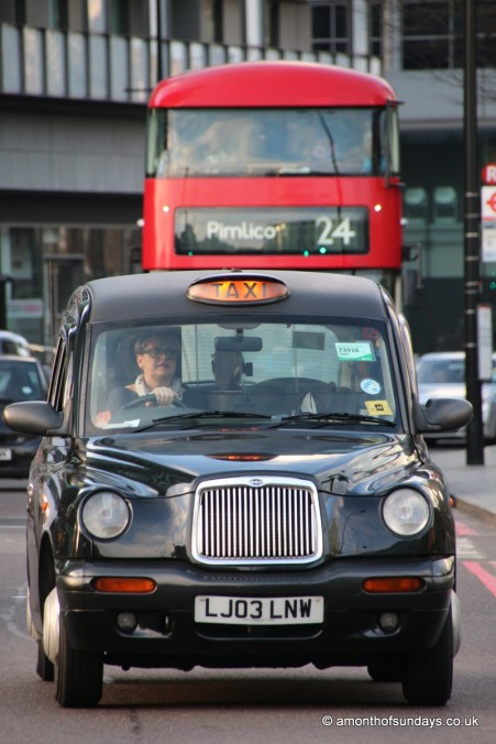London black cab with female driver and new Routemaster bus