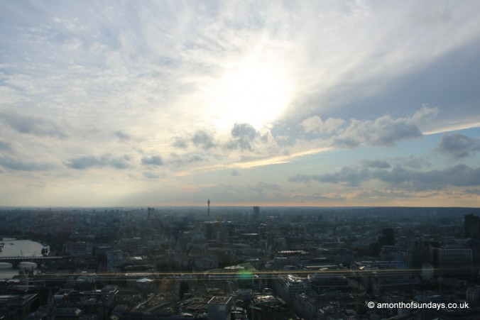 Sun setting over the city of London