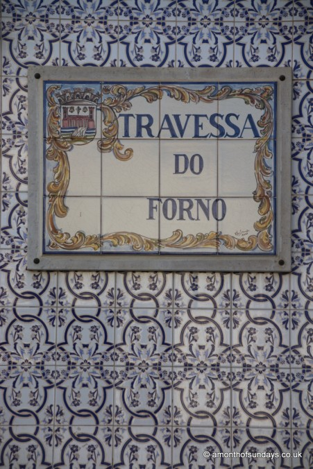 Street sign and tiles in Tavira