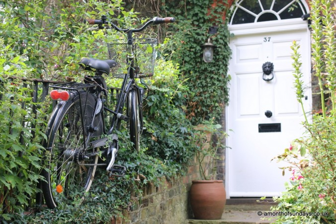 Bike next to front door in Hampstead