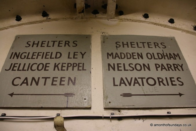 Navigation signs in Clapham South Deep Level Shelter